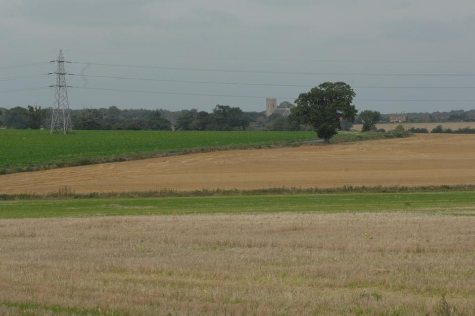open farmland with hedges woodland with an isolated church in  N Suffolk (© Suffolk County Council)