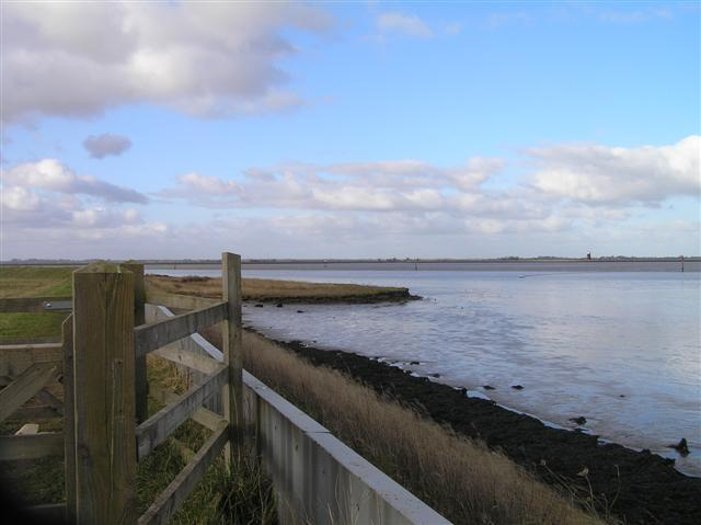 Breydon Water showing flood defence in foreground. (© L Marsden / A Yardy)